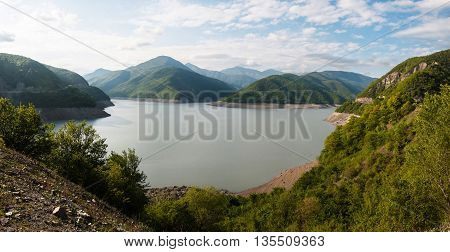 Zhinvali reservoir on the Aragvi River in the spring Georgia. Panorama.
