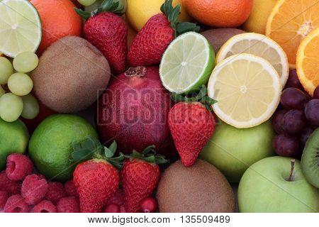 Juicy health fruit selection forming a background. High in antioxidants, vitamins, anthocyanins and dietary fiber.
