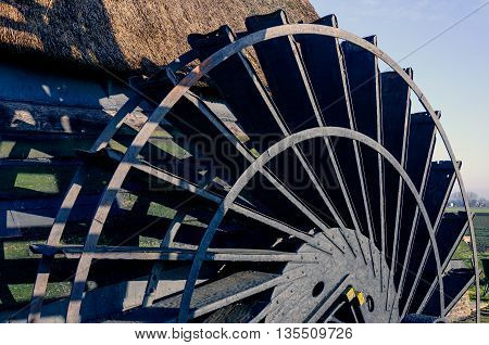 Close-up of the paddlewheel of a historic Dutch polder windmill built in 1699. It is a sunny day in the winter season.
