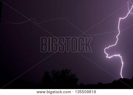 Lightning bolt of lightning at night in the summer.