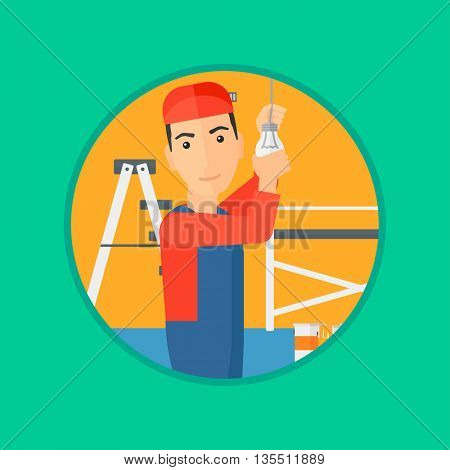 An electrician twisting a light bulb. An electrician installing light in an apartment. Electrician changing light bulb. Vector flat design illustration in the circle isolated on background.