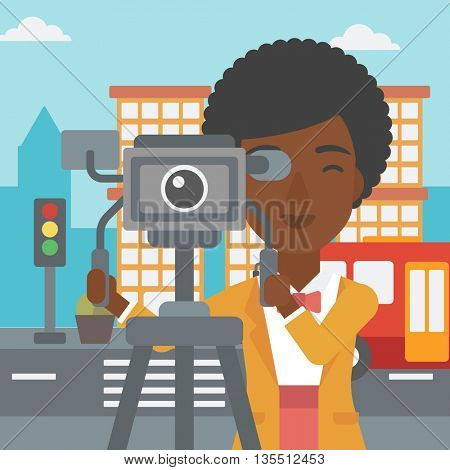 An african-american camerawoman looking through movie camera on a city background vector flat design illustration. Square layout.