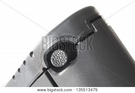 Button on a polymer rifle stock that opens the battery compartment