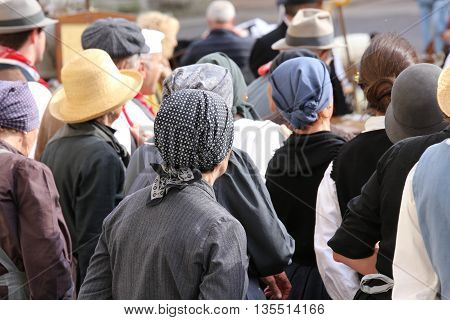 Many People With Old Haircloth Waiting