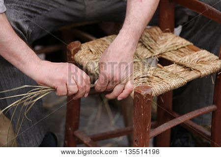 Senior Mender Of Chairs While With Straw Shelters The Old Wooden