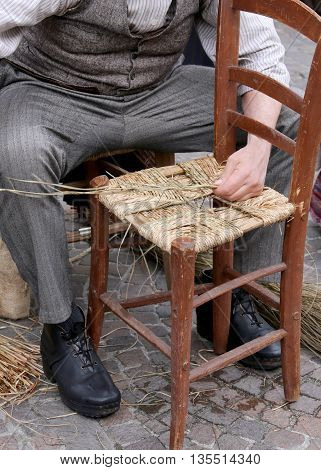 Mender Of Chairs While Repairing A Chair