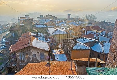 The winter sun penetrates between the roofs of the old houses on the Hisar Castle Hill in Ankara Turkey.