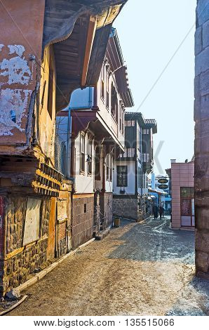 ANKARA TURKEY - JANUARY 16 2015: The winding narrow street of the Turkish village leads to the old Hisar Castle located on the top of the hill on January 16 in Ankara.