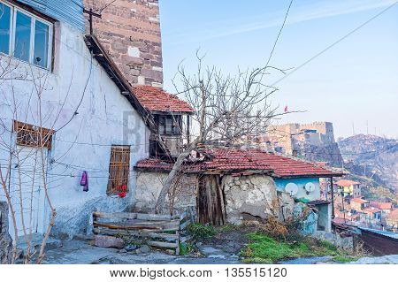 The dilapidated leaving house on the Castle Hill of Ankara with Hisar citadel on the background Turkey.