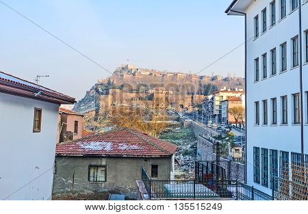The Hisar Castle Hill with the old fortress and massive ramparts through the residential houses of Ulus district Ankara Turkey.