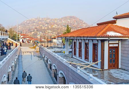 ANKARA TURKEY - JANUARY 16 2015: The modern market street of the old Ankara with the view on the hill with the slums of Ulus district on January 16 in Ankara.