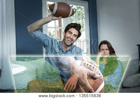 Composite image of man is watching american football match next to his bored wife at home