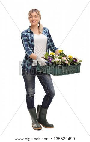 Full length portrait of a cheerful woman holding a rack of flowers isolated on white background