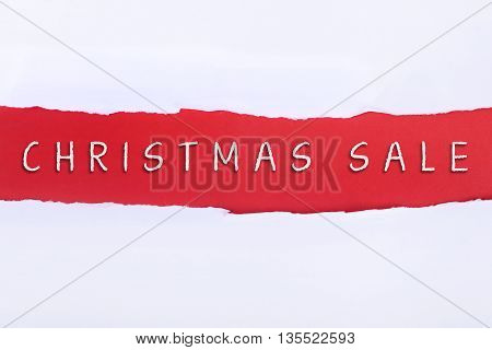 Torn paper with a PROMOTION word on red background.