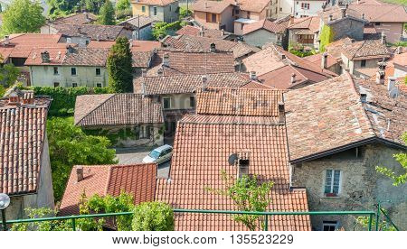Terra cotta tile rooftops of a typical Mediterranean village in Italy