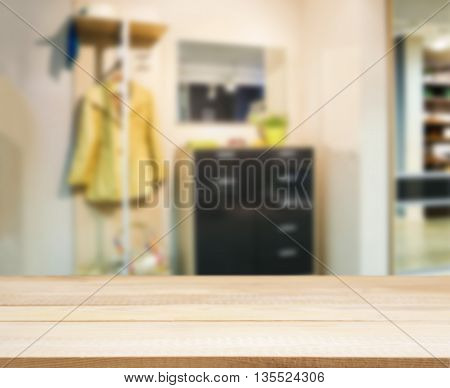 Wooden empty table in front of blurred background. Perspective light wood over blur in modern apartment interior. Mock up for display or montage your products