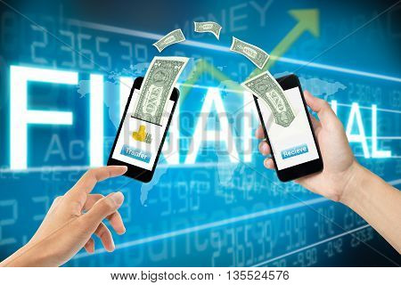 mobile banking online money transfer concept with two hands holding smart phone and screen mobile phone transfer button receive and dollar bills above on blue finance background.