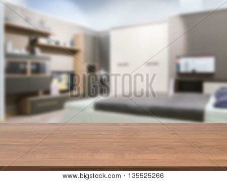 Wooden board empty table in front of blurred background. Perspective dark wood over blur in modern comfortable bedroom with white bed. Mock up for display or montage your products