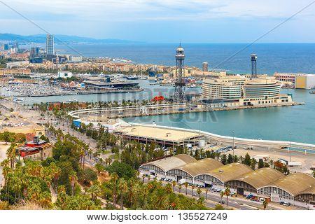 Aerial view over Port Vell marina, Passeig de Colom, Barceloneta and Rambla de Mar in Barcelona, Catalonia, Spain