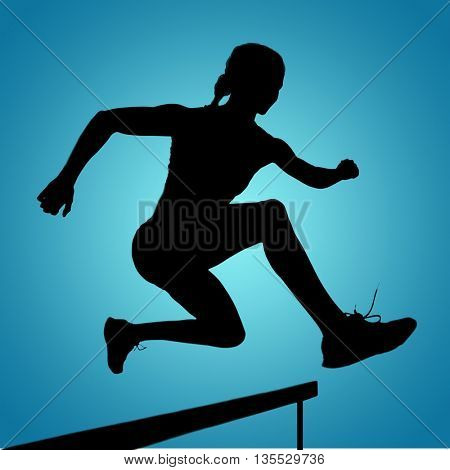 Sporty woman jumping a hurdle against blue vignette background