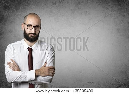 crafty businessman with hands crossed on the wall