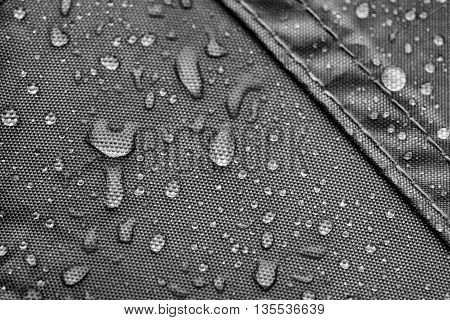 Grey rainproof tent sheet with rain drops