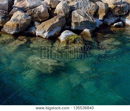 Big rocks in water, mediteranean see on Italy coast