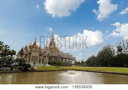 Main Pagoda of Nonkum Temple with blue sky Seekhio Nakhon Ratchasima Thailand (Wat Non kum)