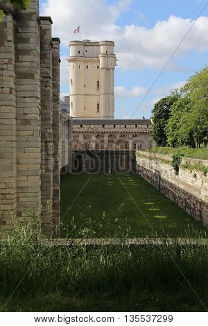 PARIS, FRANCE - MAY 15, 2015: This is donjon and part of the fortress walls with a former moat of the castle of Vincennes.
