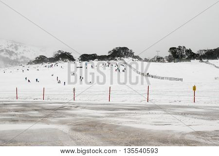 Perisher Valley - 23 June 2016: Lots of fun being had on the toboggan slope at Perisher Valley ski resort