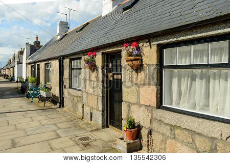 Typical cottage in the small village of Footdee (aka Fittie). A nineteenth century fishing village close to entrance of Aberdeen harbour.