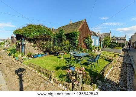 Attractive garden in the small village of Footdee (aka Fittie). A nineteenth century fishing village close to entrance of Aberdeen harbour.