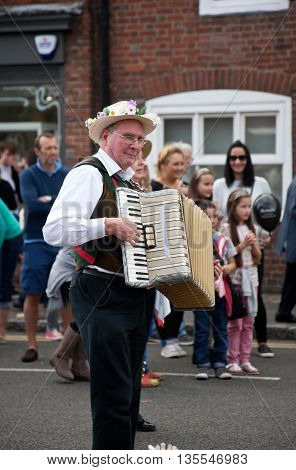 AMERSHAM, UK - SEPTEMBER 13: As part of the entertainment at the annual Amersham Heritage day event Morris dancers demonstrate old English folk dancing to the public on September 13, 2015 in Amersham