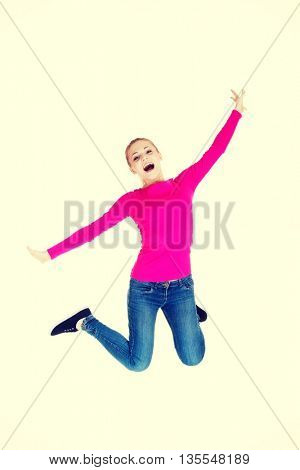 Young caucassian woman is jumping.