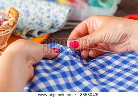 Hand Sew. Female Hands Patiently And Wisely Sewing.