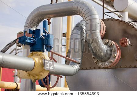 gas processing plant. Place in a large industrial boiler room.