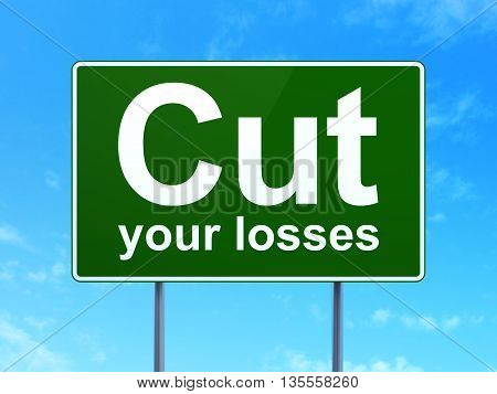 Finance concept: Cut Your losses on green road highway sign, clear blue sky background, 3D rendering