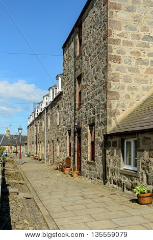 Terraced cottages in the small village of Footdee (aka Fittie). A nineteenth century fishing village close to entrance of Aberdeen harbour.