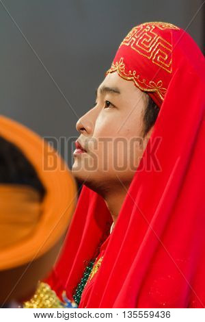 Thanh Hoa, Vietnam - October 19, 2014: A male medium is dressed up and about to perform Len Dong, a spirit mediumship ritual in Central Vietnam. In trance the medium channels goddesses of the Dao Mau religion.