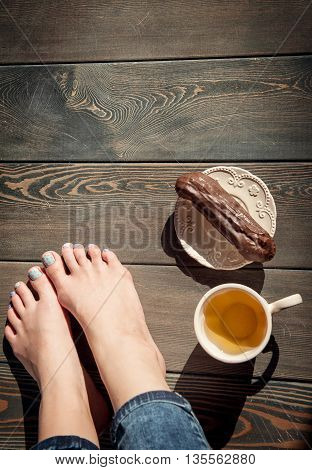 Cozy Photo Of Young Woman Feet With Tea And Cake On The Floor