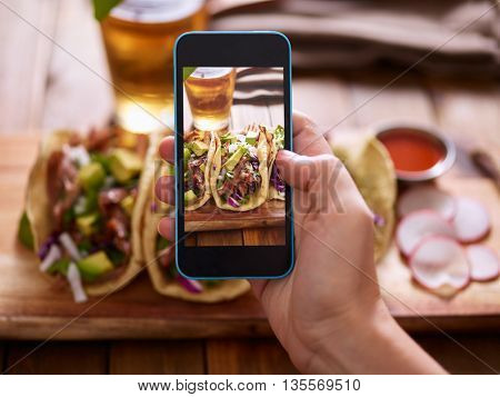 Taking photo of street tacos with smartphone
