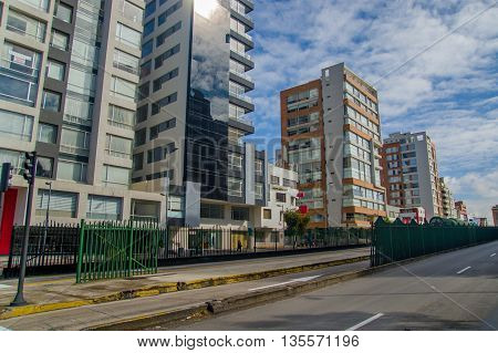 QUITO, ECUADOR - JULY 7, 2015: Quito on sunday, neighborhood on the north part of the city, buildings and sun.