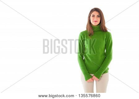Portrait of happy young woman. Beautiful female is wearing green turtleneck sweater. She is standing isolated on white background.