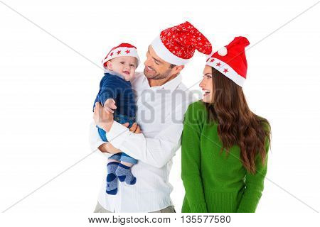 A photo of happy parents with son. Family of three are wearing Santa hats. They are in casuals isolated over white background.