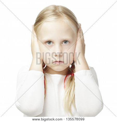 Child closed his hands over his ears and hears nothing