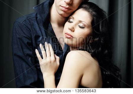 Loving couple sensuality woman with man on black