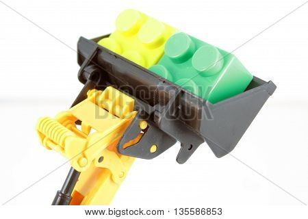 Kids bulldozer toy. Dredge toy with some color blocks.