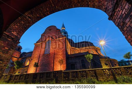 View on the Church from under the arch in historical part of Katowice Poland