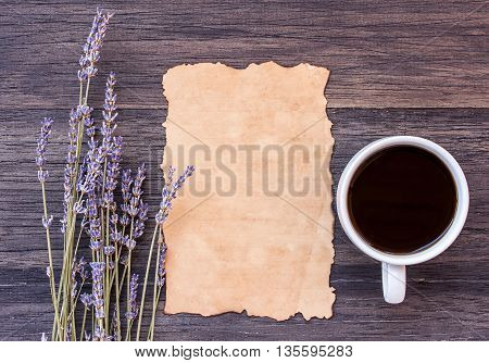 Old paper and coffee with lavender flower on dark wooden table background. top view with copy space