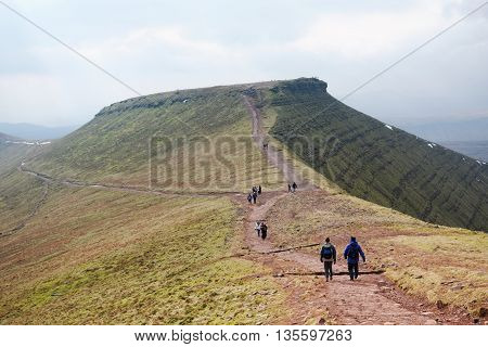 BRECON BEACONS, WALES, 27 FEB 2016.  Editorial Photograph of Hikers at Summit of Corn Du in the Brecon Beacons National Park